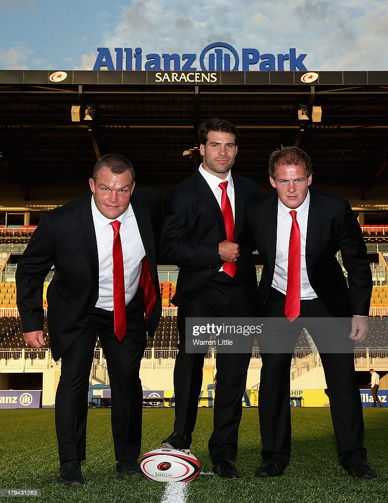 Matt Stevens Schalk Britz and Rhys Gill of Saracens pose with their new Apsley taylored suits during the season launch at Allianz Park on September 3...