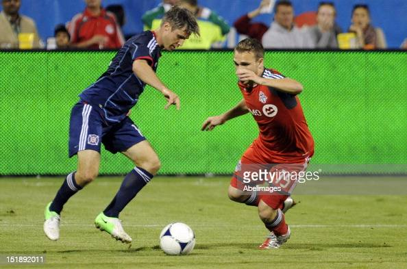 Matt Stinson of Toronto FC gets beat by Logan Pause of the Chicago Fire during MLS action at the BMO Field September 12 2012 in Toronto Ontario Canada