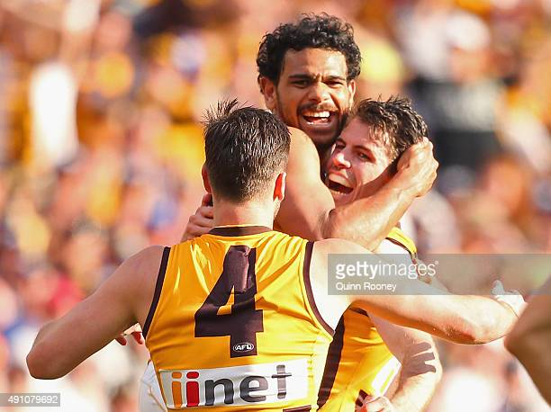 Matt Suckling Cyril Rioli and Isaac Smith of the Hawks celebrate a goal during the 2015 AFL Grand Final match between the Hawthorn Hawks and the West...