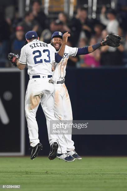 Matt Szczur and Manuel Margot of the San Diego Padres celebrate after the final out during the game against the Atlanta Braves at Petco Park on June...