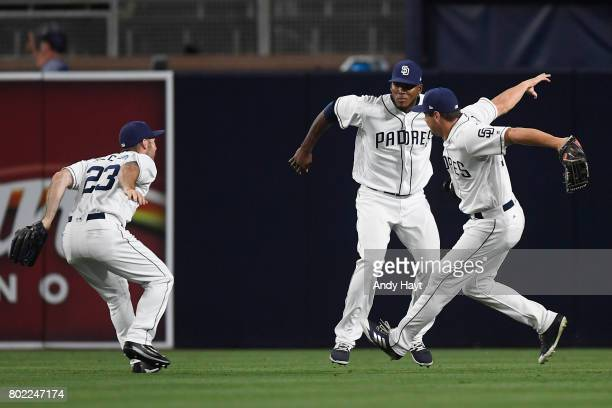Matt Szczur Franchy Cordero and Hunter Renfroe of the San Diego Padres celebrate after the final out during the game against the Detroit Tigers at...