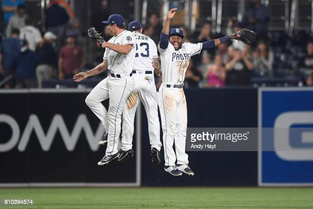 Matt Szczur Hunter Renfroe and Manuel Margot of the San Diego Padres celebrate after the final out during the game against the Atlanta Braves at...