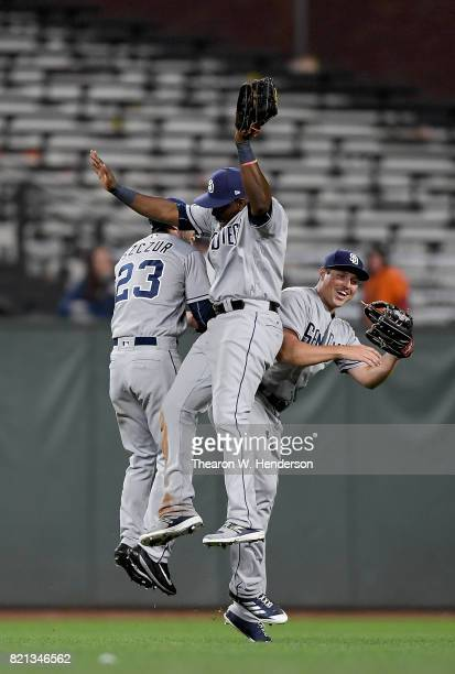 Matt Szczur Jose Pirela and Hunter Renfroe of the San Diego Padres celebrates defeating the San Francisco Giants 129 in 11 inning at ATT Park on July...