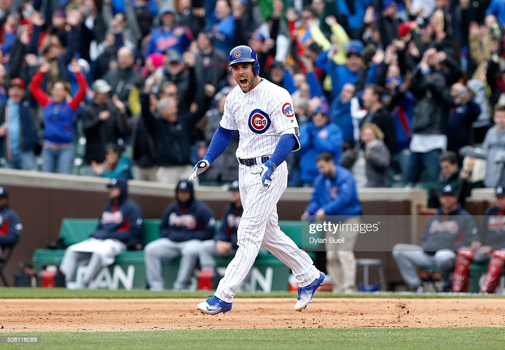 Matt Szczur #20 of the Chicago Cubs reacts after hitting a grand slam in the eighth inning against the Atlanta Braves at Wrigley Field on April 29, 2016 in Chicago, Illinois.