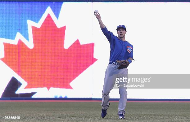 Matt Szczur of the Chicago Cubs warms up in center field before the start of the inning during MLB game action against the Toronto Blue Jays on...