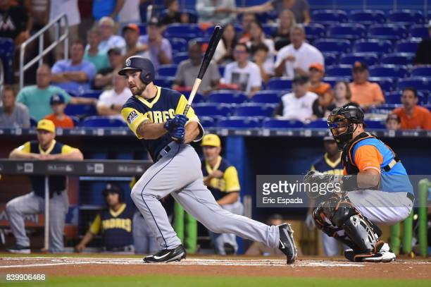 Matt Szczur of the San Diego Padres doubles in the first inning against the Miami Marlins at Marlins Park on August 27 2017 in Miami Florida