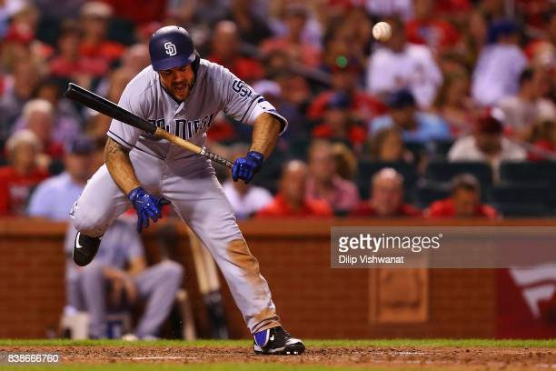 Matt Szczur of the San Diego Padres his hit bay a pitch against the St Louis Cardinals in the eighth inning at Busch Stadium on August 24 2017 in St...