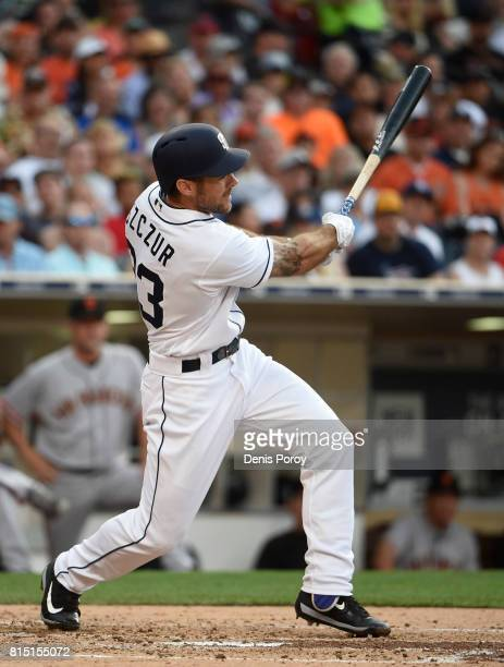 Matt Szczur of the San Diego Padres hits a solo home run during the third inning of a baseball game against the San Francisco Giants at PETCO Park on...