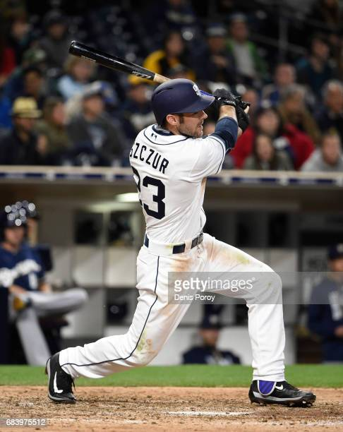 Matt Szczur of the San Diego Padres hits an RBI double during the seventh inning of a baseball game against the Milwaukee Brewers at PETCO Park on...