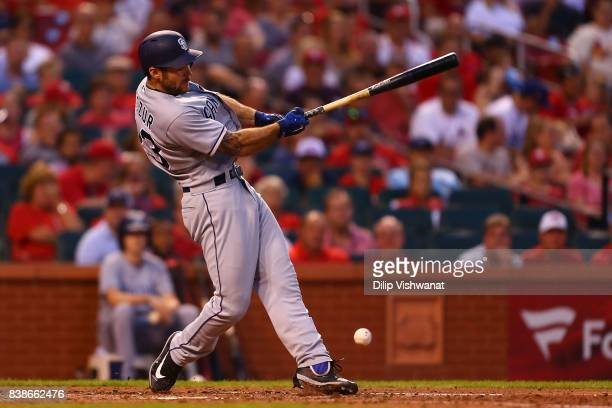 Matt Szczur of the San Diego Padres hits an RBI single against the St Louis Cardinals in the sixth inning at Busch Stadium on August 24 2017 in St...