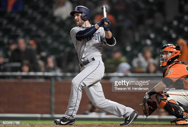 Matt Szczur of the San Diego Padres hits an rbi single to score Hunter Renfroe against the San Francisco Giants in the top of the 11th inning at ATT...
