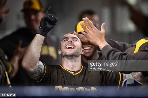Matt Szczur of the San Diego Padres is congratulated after hitting a solo home run during the seventh inning of a baseball game against the Kansas...