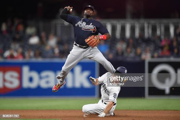 Matt Szczur of the San Diego Padres is kicked in the helmet as Brandon Phillips of the Atlanta Braves starts a double play during the game at Petco...