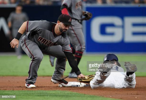 Matt Szczur of the San Diego Padres is tagged out by Daniel Descalso of the Arizona Diamondbacks as he tries to steal second base during the second...