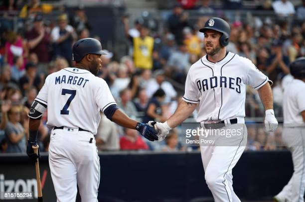Matt Szczur of the San Diego Padres right is congratulated by Manuel Margot after hitting a solo home run during the third inning of a baseball game...