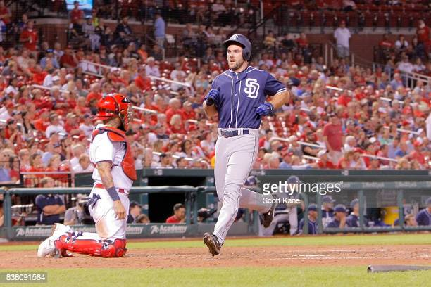 Matt Szczur of the San Diego Padres scores a run during the eighth inning against the St Louis Cardinals at Busch Stadium on August 23 2017 in St...