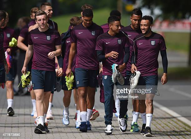 Matt Targett Ruben LoftusCheek Jesse Lingard and Nathan Redmond look on as the squad walk to training during the England U21 training session and...