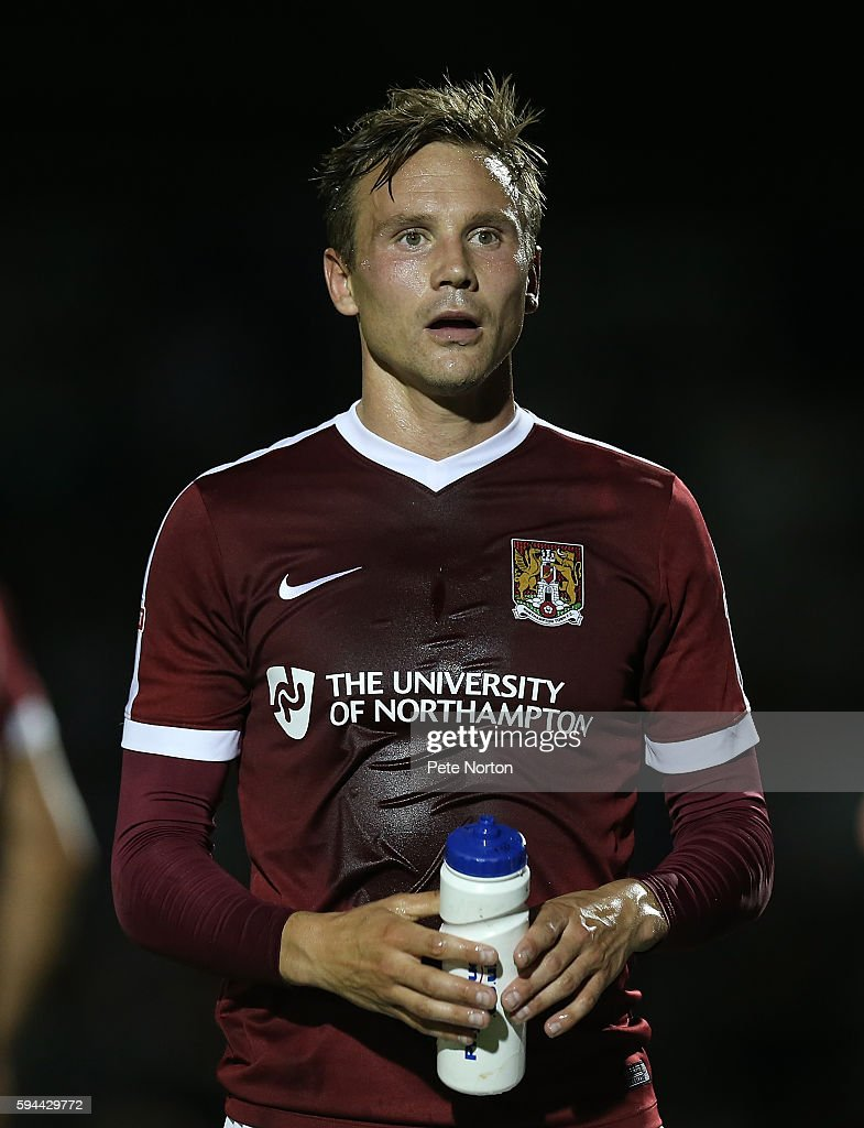 Matt Taylor of Northampton Town cools down with a bottle of water during the EFL Cup second round match between Northampton Town and West Bromwich...