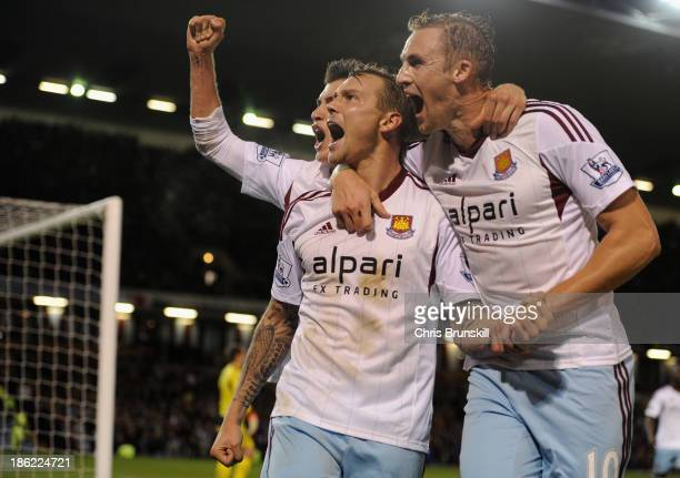Matt Taylor of West Ham celebrates scoring the opening goal from the penalty spot with his teammates during the Capital One Cup Fourth Round match...