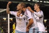 Matt Taylor of West Ham celebrates scoring the opening goal from the penalty spot with his teammates Daniel Potts and Jack Collison during the...