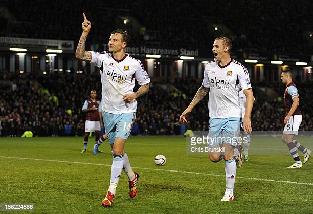 Matt Taylor of West Ham celebrates scoring the opening goal from the penalty spot during the Capital One Cup Fourth Round match between Burnley and...