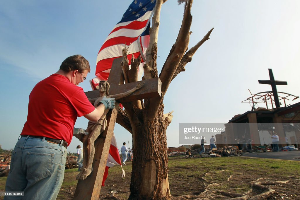 Matt Teel cleans off a Jesus statue after they found it in St. Mary's church as they salvage what they can from the building that was destroyed when a massive tornado passed through the town killing at least 132 people on May 28, 2011 in Joplin, Missouri. As the town continues the process of recovering from the storm over 150 people are still missing and funerals have begun for the victims of the deadly tornado that struck on May 22.