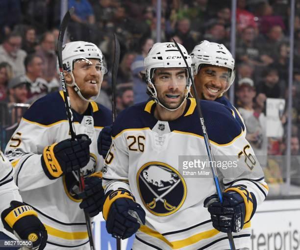 Matt Tennyson Matt Moulson and Evander Kane of the Buffalo Sabres celebrate after a firstperiod goal scored by Ryan O'Reilly against the Vegas Golden...