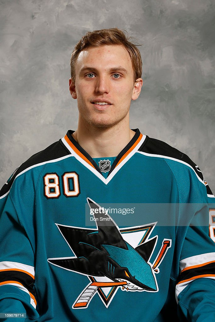 Matt Tennyson #80 of the San Jose Sharks poses for his official headshot for the 2012-13 season on January 13, 2013 at Sharks Ice in San Jose, California.