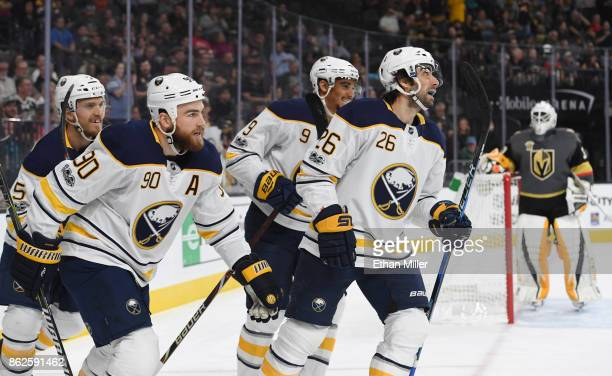 Matt Tennyson Ryan O'Reilly Evander Kane and Matt Moulson of the Buffalo Sabres celebrate after a firstperiod goal scored by O'Reilly against Malcolm...