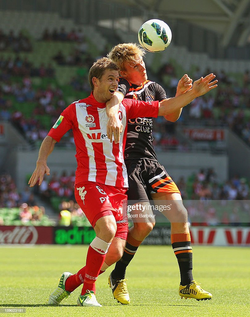 Matt Thompson of the Heart and Ben Halloran of the Roar compete for the ball during the round 15 A-League match between the Melbourne Heart and the Brisbane Roar at AAMI Park on January 6, 2013 in Melbourne, Australia.