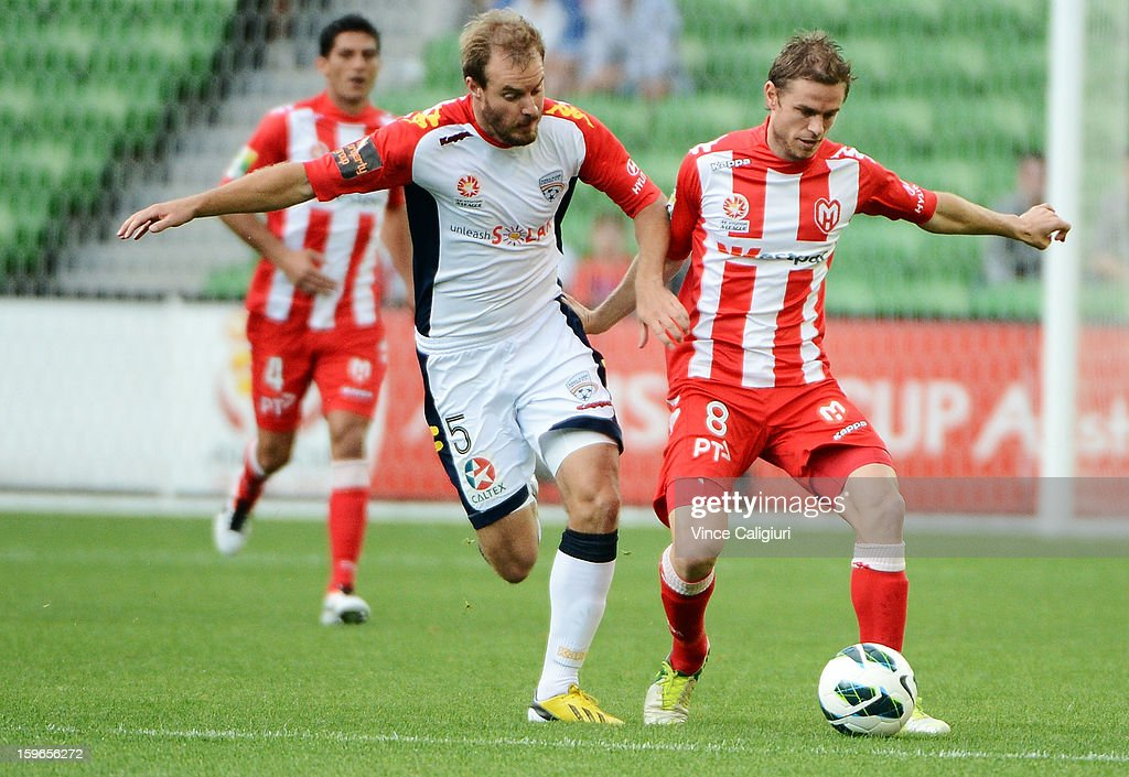 Matt Thompson of the Heart and Iain Fyfe (L) of United contest the ball during the round seventeen A-League match between Melbourne Heart and Adelaide United at AAMI Park on January 18, 2013 in Melbourne, Australia.