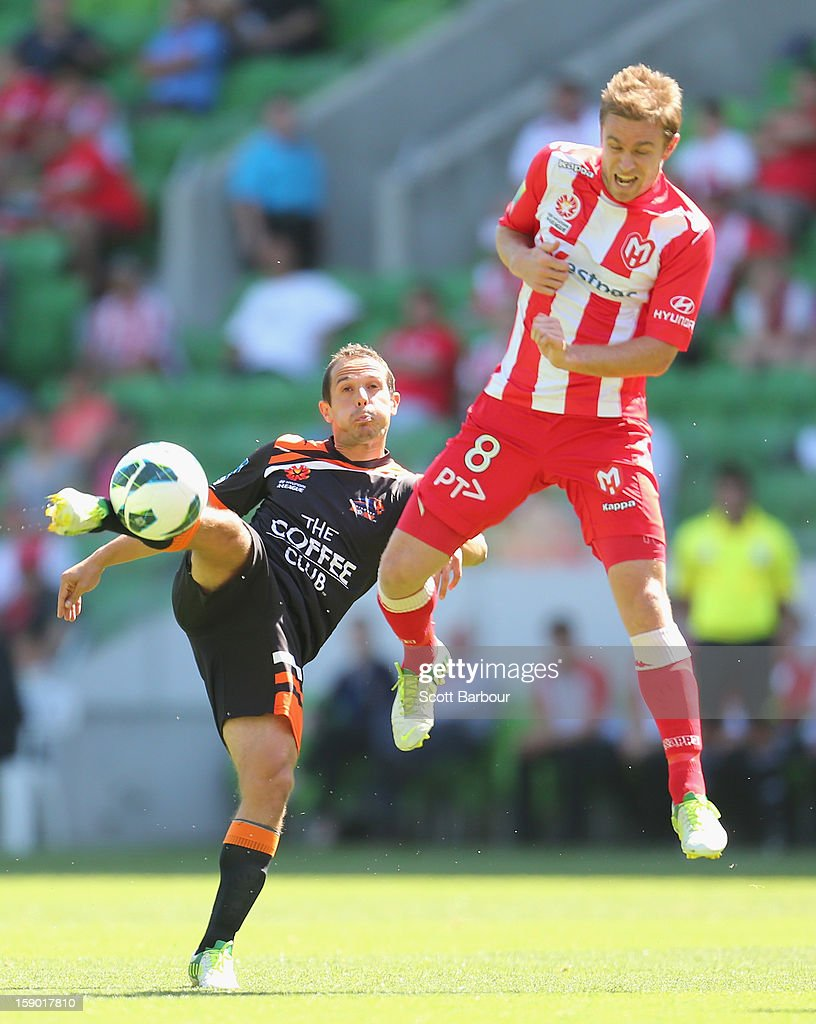 Matt Thompson of the Heart and Massimo Murdocca of the Roar compete for the ball during the round 15 A-League match between the Melbourne Heart and the Brisbane Roar at AAMI Park on January 6, 2013 in Melbourne, Australia.