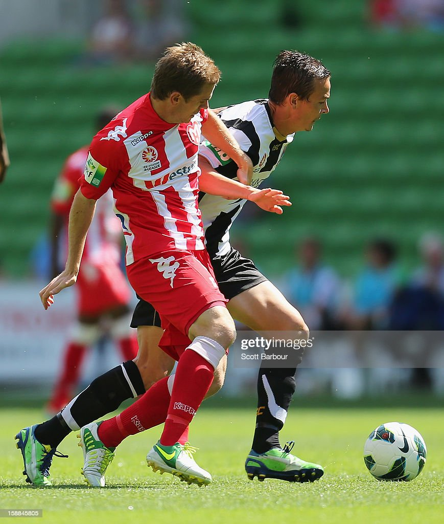 Matt Thompson of the Heart and Ryan Griffiths of the Jets compete for the ball during the round 14 ALeague match between Melbourne Heart and the...