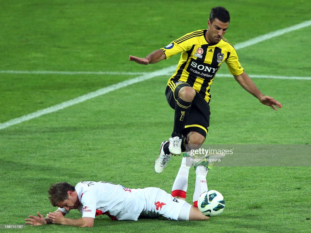 Matt Thompson of the Heart goes down in the tackle of Manny Muscat of the Phoenix during the round 13 A-League match between the Wellington Phoenix and the Melbourne Heart at Westpac Stadium on December 27, 2012 in Wellington, New Zealand.