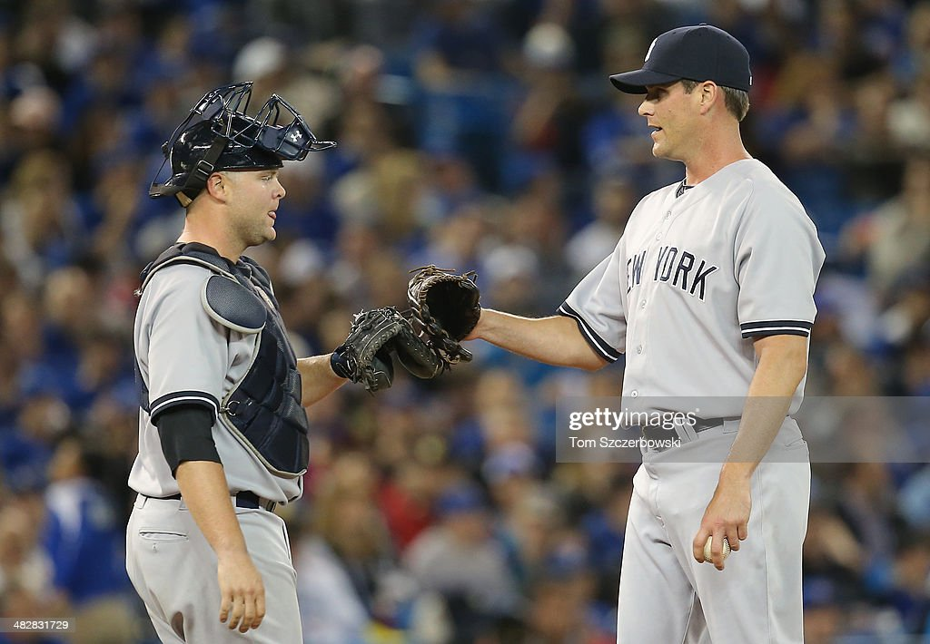 <a gi-track='captionPersonalityLinkClicked' href=/galleries/search?phrase=Matt+Thornton&family=editorial&specificpeople=240259 ng-click='$event.stopPropagation()'>Matt Thornton</a> #48 of the New York Yankees gets a visit on the mound from <a gi-track='captionPersonalityLinkClicked' href=/galleries/search?phrase=Brian+McCann+-+Baseball+Player&family=editorial&specificpeople=593065 ng-click='$event.stopPropagation()'>Brian McCann</a> #34 and is congratulated after getting a strikeout in the eighth inning during MLB game action against the Toronto Blue Jays on April 4, 2014 at Rogers Centre in Toronto, Ontario, Canada.