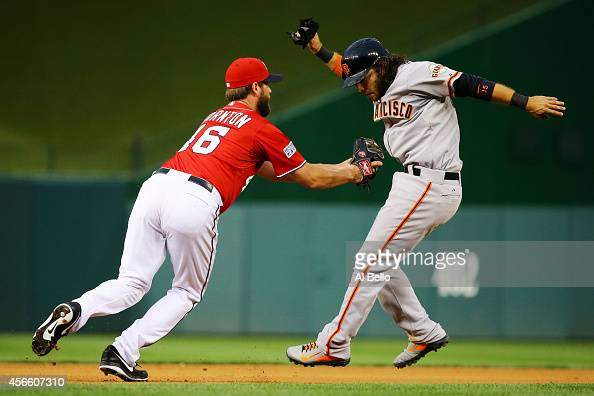 Matt Thornton of the Washington Nationals tags out Brandon Crawford of the San Francisco Giants in a rundown in the eighth inning during Game One of...