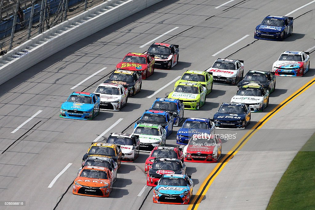 Matt Tifft, driver of the #18 NOS Energy Drink Toyota, and Daniel Suarez, driver of the #19 ARRIS Toyota, lead a pack of cars during the NASCAR XFINITY Series Sparks Energy 300 at Talladega Superspeedway on April 30, 2016 in Talladega, Alabama.