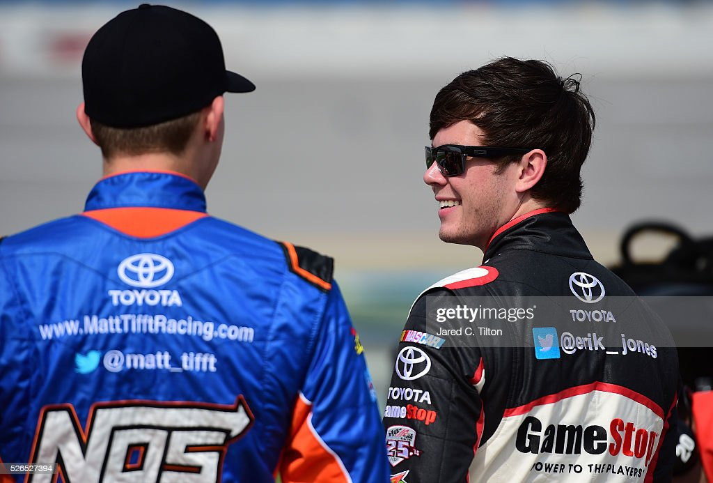 Matt Tifft, driver of the #18 NOS Energy Drink Toyota, talks to Erik Jones, driver of the #20 GameStop Toyota, on the grid during qualifying for the NASCAR XFINITY Series Sparks Energy 300 at Talladega Superspeedway on April 30, 2016 in Talladega, Alabama.