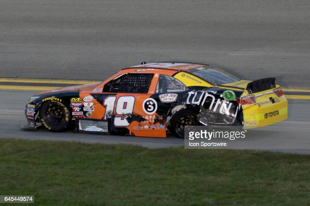Matt Tifft driver of the Tunity Toyota brings the damaged 19 to the pits during the running of the NASCAR Xfinity Series PowerShares QQQ 300 on...