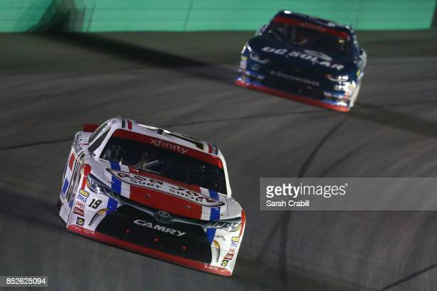 Matt Tifft driver of the VstMyrtleBchcom/RnJnShp/SrfcSnscrn Toyota leads Brennan Poole driver of the DC Solar Chevrolet during the NASCAR XFINITY...