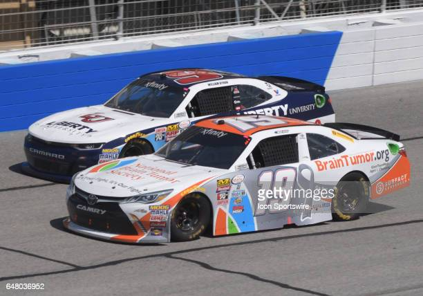 Matt Tifft Joe Gibbs Racing NBTS Brain Tumororg Toyota Camry and William Byron JR Motorsports Liberty University Chevrolet Camaro race side by side...