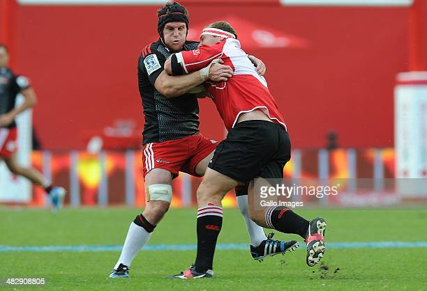 Matt Todd of Crusaders is tackled by Schalk van der Merwe of Lions during the Super Rugby match between Lions and Crusaders at Ellis Park on April 05...
