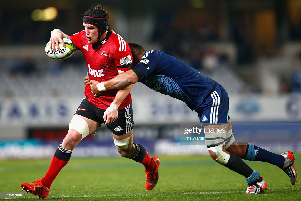 <a gi-track='captionPersonalityLinkClicked' href=/galleries/search?phrase=Matt+Todd&family=editorial&specificpeople=5870233 ng-click='$event.stopPropagation()'>Matt Todd</a> of the Crusaders is tackled by Joe Edwards of the Blues during the round 17 Super Rugby match between the Blues and the Crusaders at Eden Park on June 6, 2015 in Auckland, New Zealand.