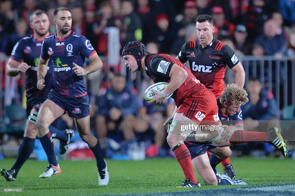 Matt Todd of the Crusaders runs with the ball during the round 11 Super Rugby match between the Crusaders and the Reds at AMI Stadium on May 6, 2016 in Christchurch, New Zealand.