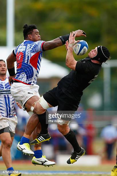 Matt Todd of the New Zealand All Blacks and Joe Tekori of Manu Samoa contest the ball during the International Test match between Samoa and the New...