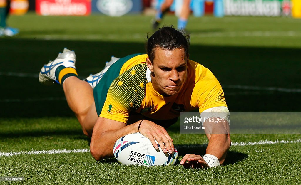 <a gi-track='captionPersonalityLinkClicked' href=/galleries/search?phrase=Matt+Toomua&family=editorial&specificpeople=4695215 ng-click='$event.stopPropagation()'>Matt Toomua</a> of Australia dives over to score their tenth try during the 2015 Rugby World Cup Pool A match between Australia and Uruguay at Villa Park on September 27, 2015 in Birmingham, United Kingdom.