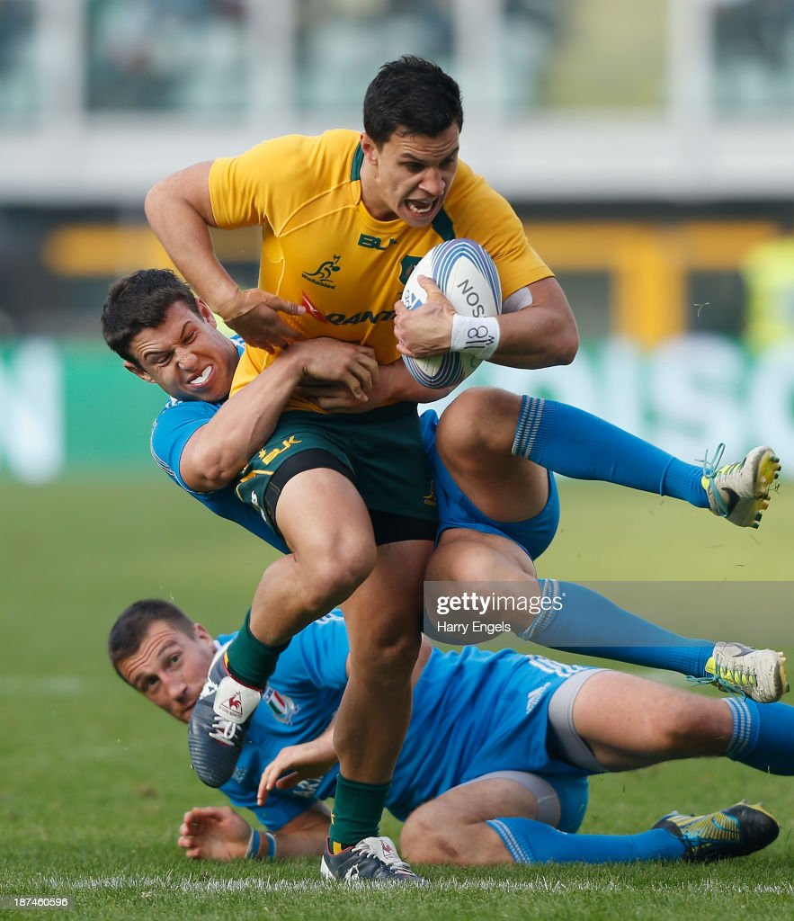 <a gi-track='captionPersonalityLinkClicked' href=/galleries/search?phrase=Matt+Toomua&family=editorial&specificpeople=4695215 ng-click='$event.stopPropagation()'>Matt Toomua</a> of Australia is tackled by Luca Morisi and Alberto Sgarbi of Italy during the international match between Italy and Australia at the Stadio Olimpico on November 9, 2013 in Turin, Italy.
