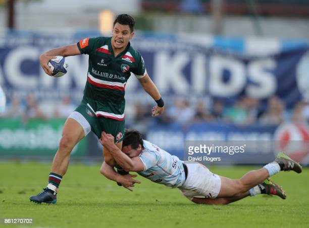 Matt Toomua of Leicester is tackled by Henry Chavancy during the European Rugby Champions Cup match between Racing 92 and Leicester Tigers at Stade...