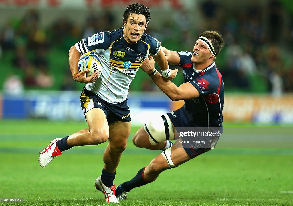 <a gi-track='captionPersonalityLinkClicked' href=/galleries/search?phrase=Matt+Toomua&family=editorial&specificpeople=4695215 ng-click='$event.stopPropagation()'>Matt Toomua</a> of the Brumbies fends off a tackle during the round seven Super Rugby match between the Rebels and the Brumbies at AAMI Park on March 28, 2014 in Melbourne, Australia.