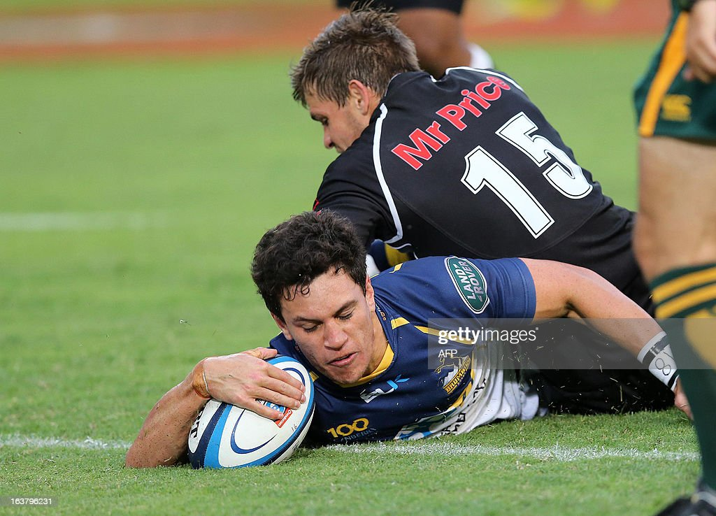 Matt Toomua of the Brumbies (bottom) goes over for the Brumbies 3rd try during the Super 15 rugby union match between the Unviersity of Canberra Brumbies of Australia and the Sharks of Durban at the Kings Park Rugby Stadium in Durban on March 16, 2013.